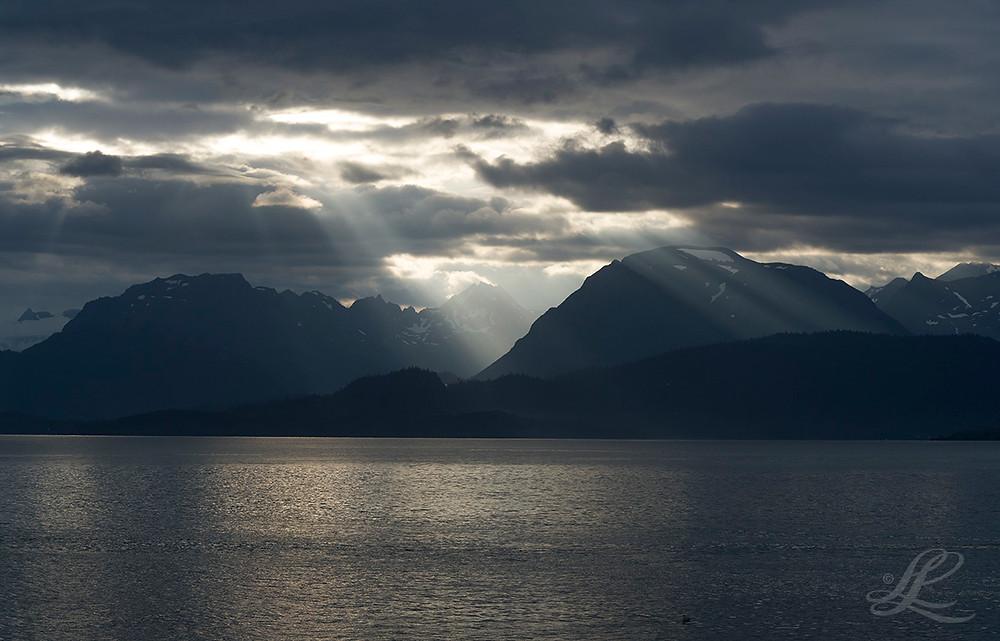Strobes from the sun over Homer, Alaska