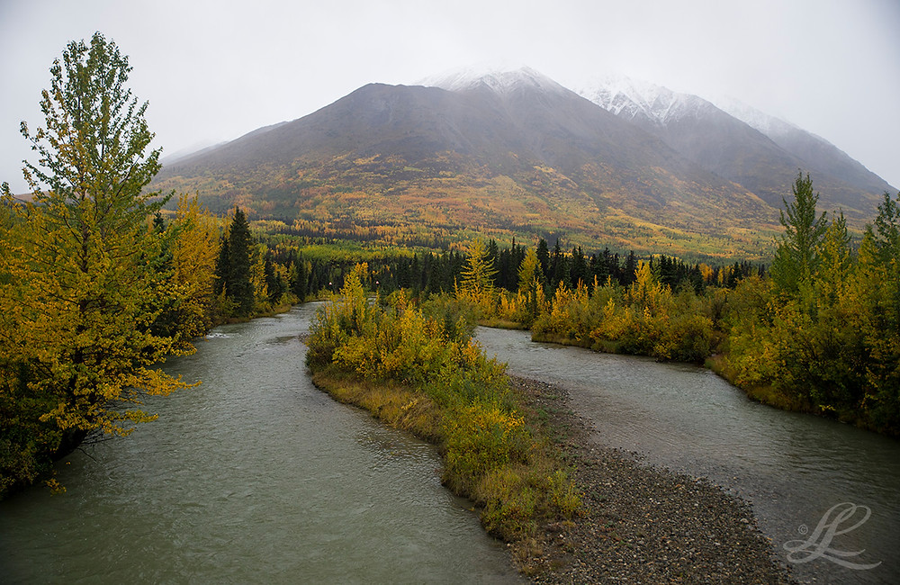RIver and terrain at the border between Yukon and BC