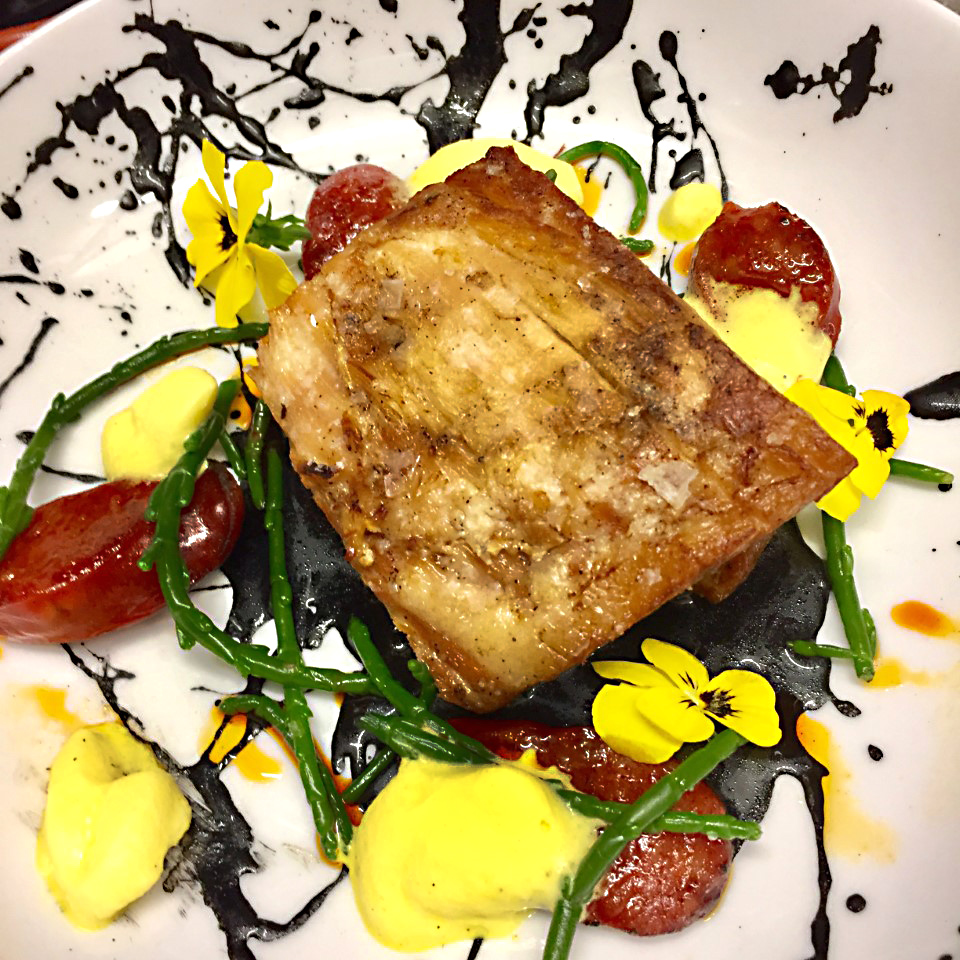 Slow braised pork belly served with samphire, chorizo, squid ink and a saffron foam