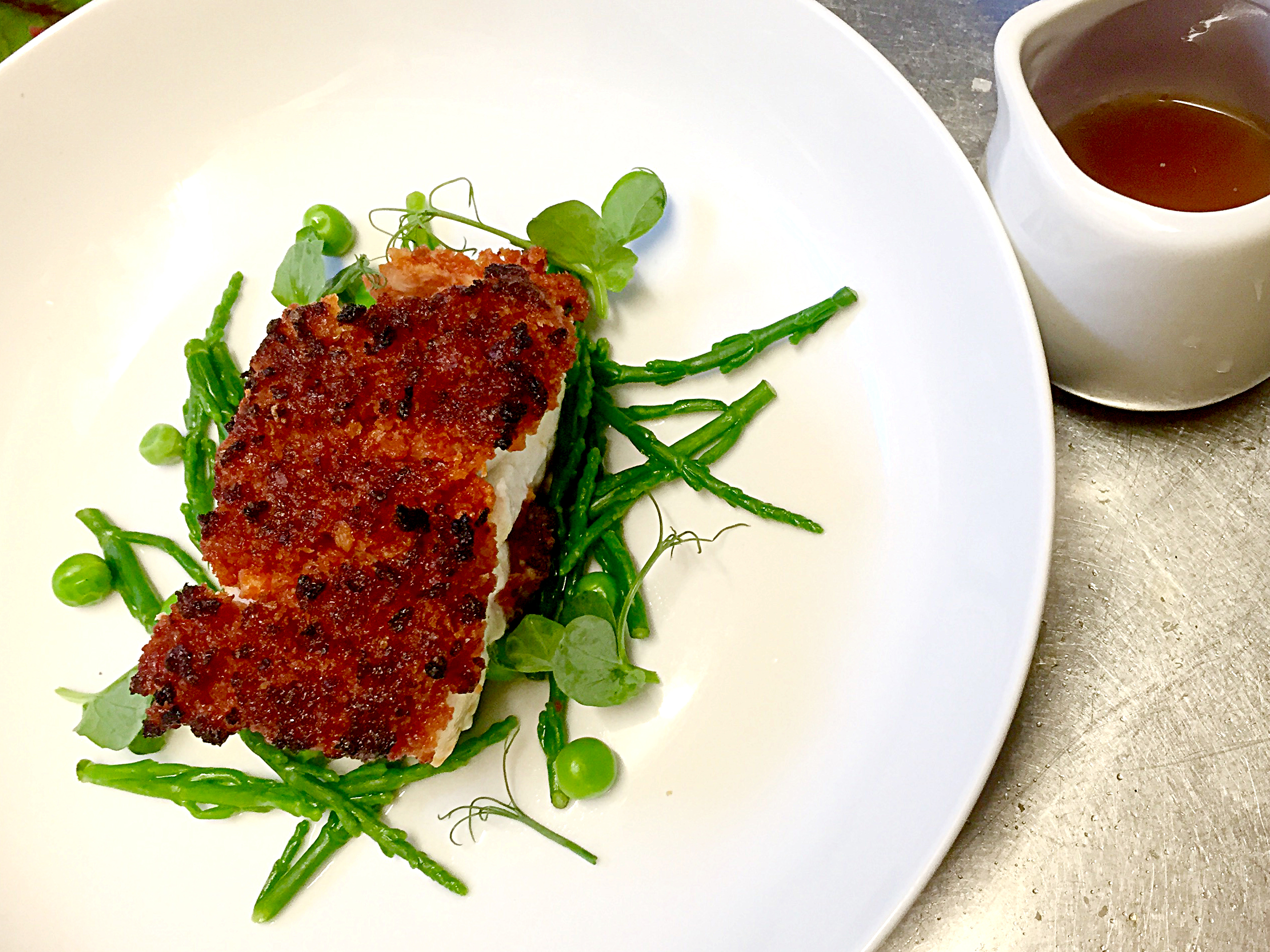 Pan roasted loin of Cod with a chorizo & lemon crust served on samphire & peas with a lobster & toma