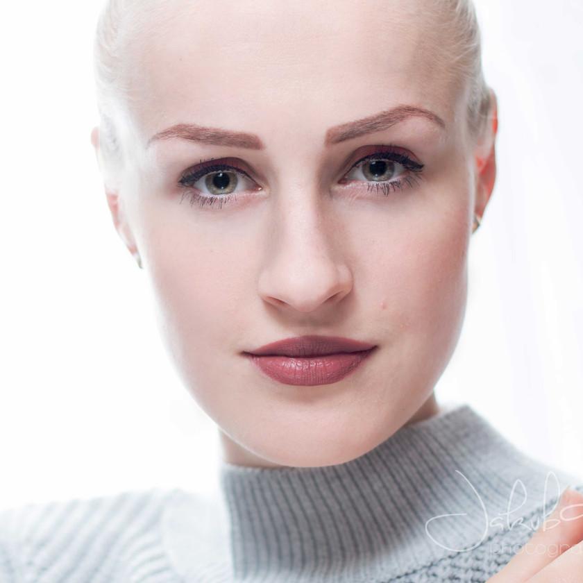 High key winter-themed headshot portrait of blonde woman. Studio portrait.