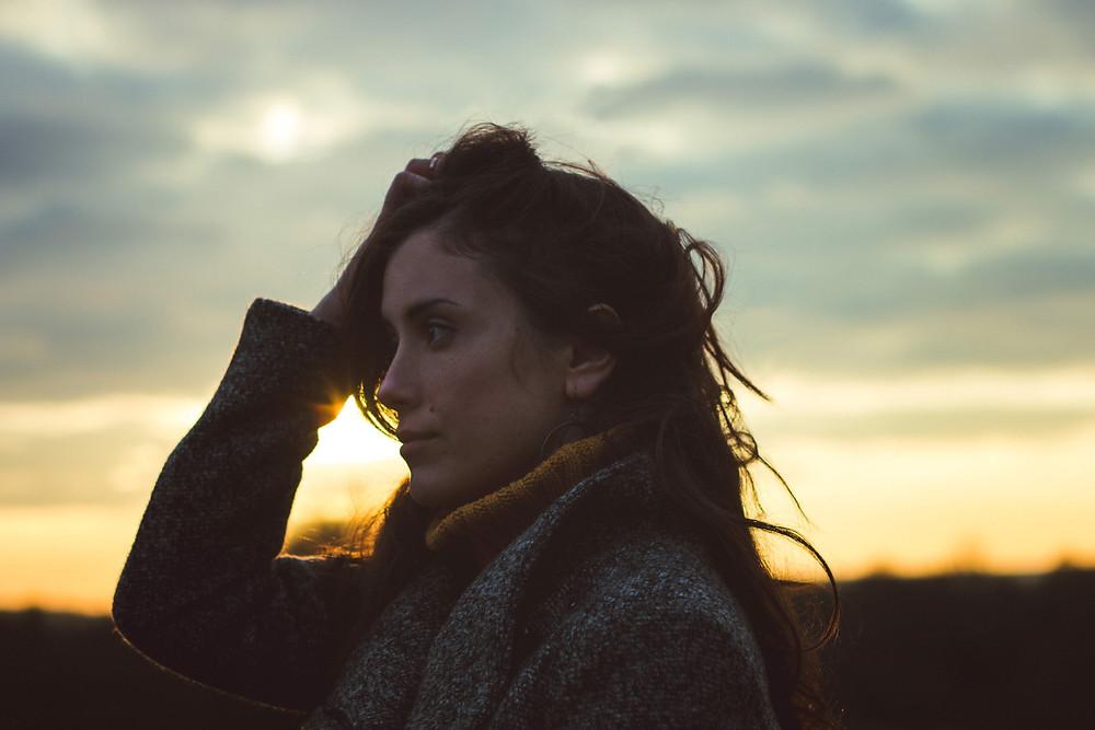 fashion photography, portrait photography, brunette woman model, mustard-yellow sweat, golden hour