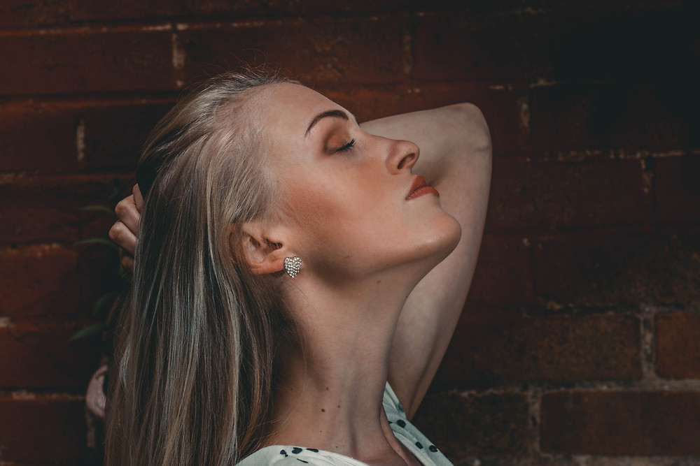 Blonde model outdoor portrait, brick wall, headshot, closed eyes, mood, dreaming, portrait photographer, Ellesmere Port,Cheshire