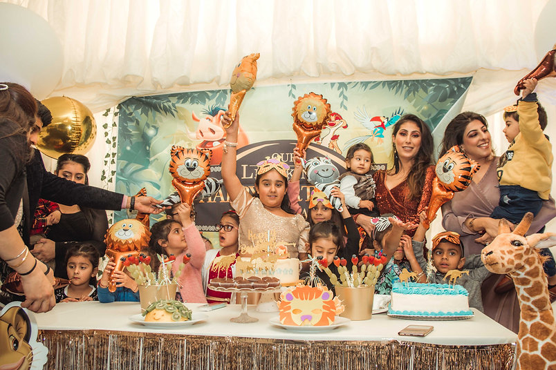 a lot of kids celebrting on birthday party, cake cutting, family event, event photographer, Cheshie, Ellesmere port