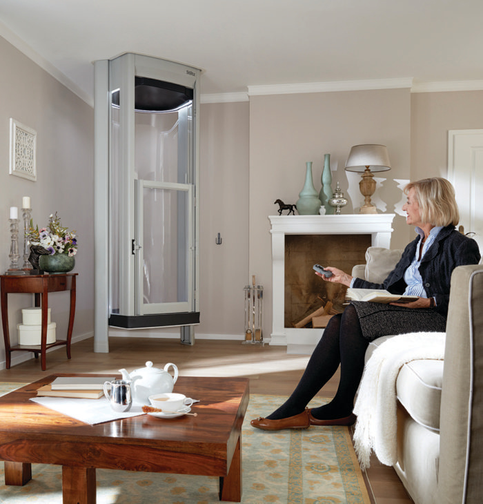 Woman pointing remote at home lift