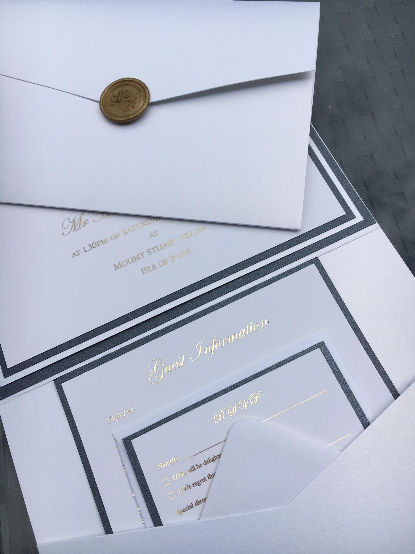 Opulent gold-foiled pocketful wedding invitation with monogrammed seal