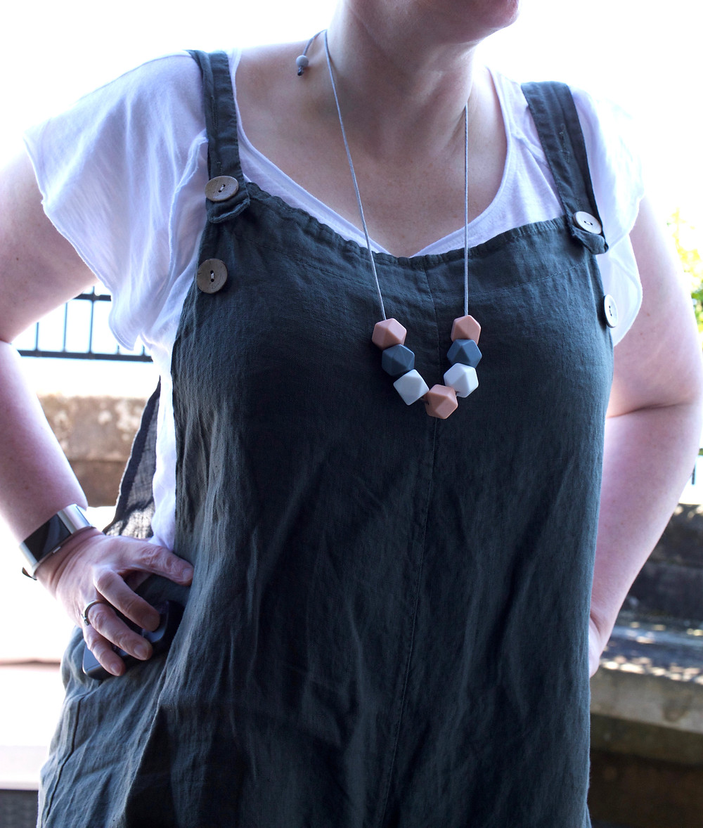 Peach, grey and white Pastel Necklace by AniMac on linen khaki dungarees