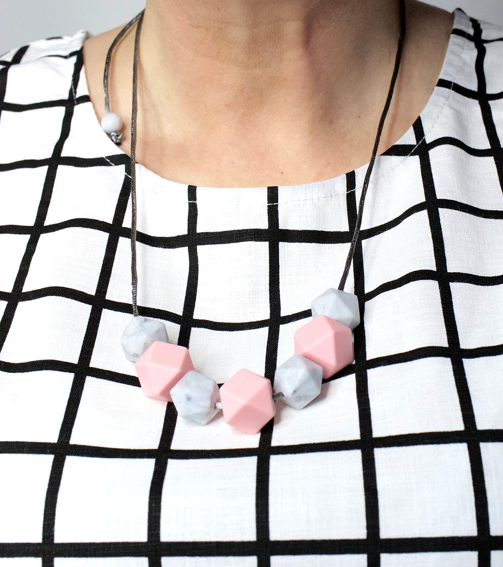 Pink and grey Pastel Necklace on a monochrome top