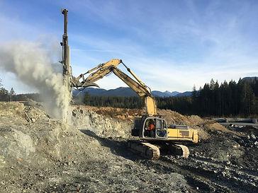 330 Excavator _with rock drill.jpg
