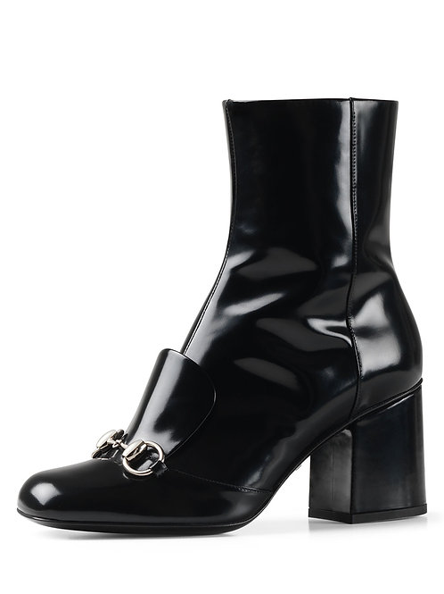 Gucci polished leather boot.