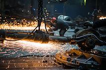 industrial-worker-cutting-and-welding-me