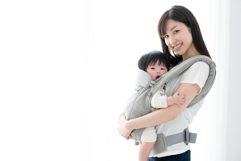 Mother carrying a baby with a smile.jpg