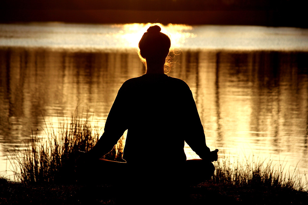 janice-allermann-sitting-in-meditation-at-sunset-in-nature