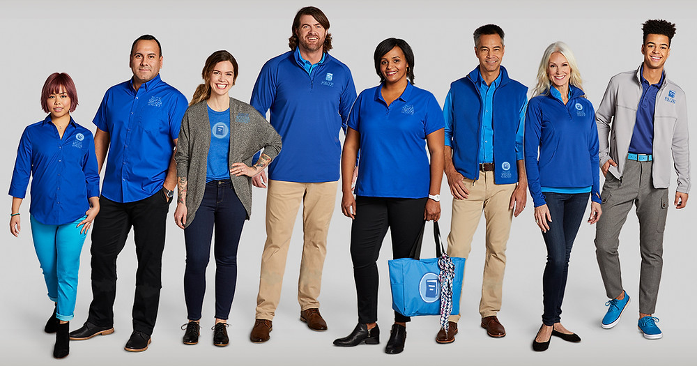 Diverse set of employees wearing customized corporate apparel