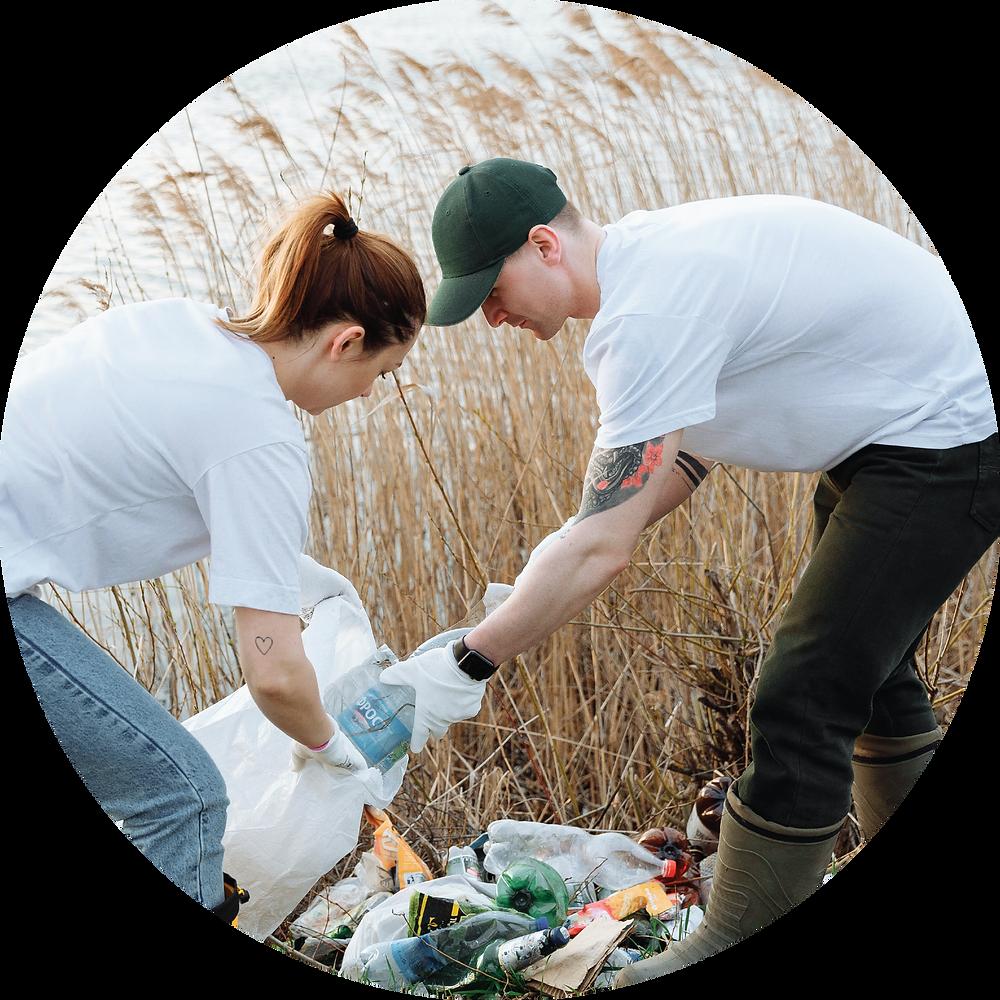two volunteers clean up garbage