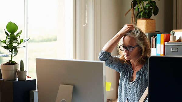 stressed-woman-with-hand-in-hair-holding