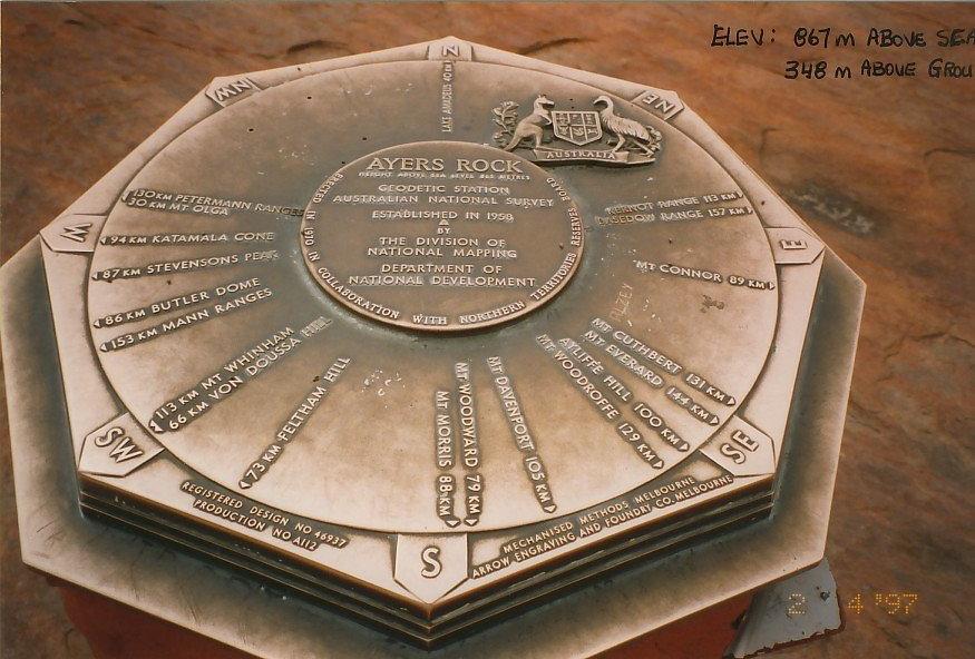 Land Survey station mark, plaque on stone monument, Ayers Rock, Ausralia