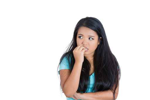 Anxious teen biting fingernails