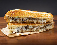 Fontina & provolone, grilled mushrooms on spicy garlic bread