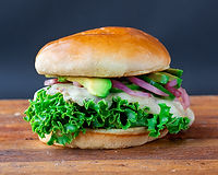 All-natural grilled chicken breast, pepper jack, sliced jalapeños, fresh avocado, lettuce, pickled onions w/ spicy ketchup