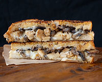 Grilled, chopped chicken breast, provolone, fontina, grilled mushrooms on spicy garlic bread