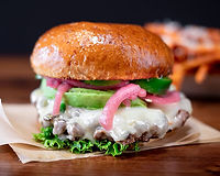 More than 1/3 pound of our signature Angus & Wagyu beef, chopped, grilled and filled with loads of melted pepper jack, sliced jalapeños, fresh avocado, lettuce, pickled onions, jalapeño pickle mix, spicy ketchup (cooked medium, pink & juicy)