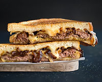 Grilled Angus & Wagyu burger patty, sweet, caramelized onions, melted swiss and provolone cheese with spicy mustard on our fresh artisan bread (burger patty cooked medium, pink, & juicy)