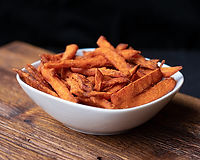 Hot and crispy Louisiana sweet potatoes seasoned with shaved parmesan.