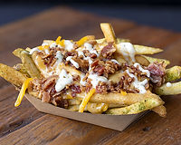 Smothered in our cheddar sauce, with crispy bacon and ranch sauce
