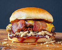 More than 1/3 pound of our signature Angus & Wagyu beef, chopped, grilled & filled with melted cheddar, smoked bacon, crispy onions, Memphis style BBQ sauce, all topped with a soft artisan bun. (Cooked medium, pink & juicy)
