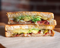 Avocado, smoked bacon, pickled jalapeños, pepper jack cheese, on artisan french bread