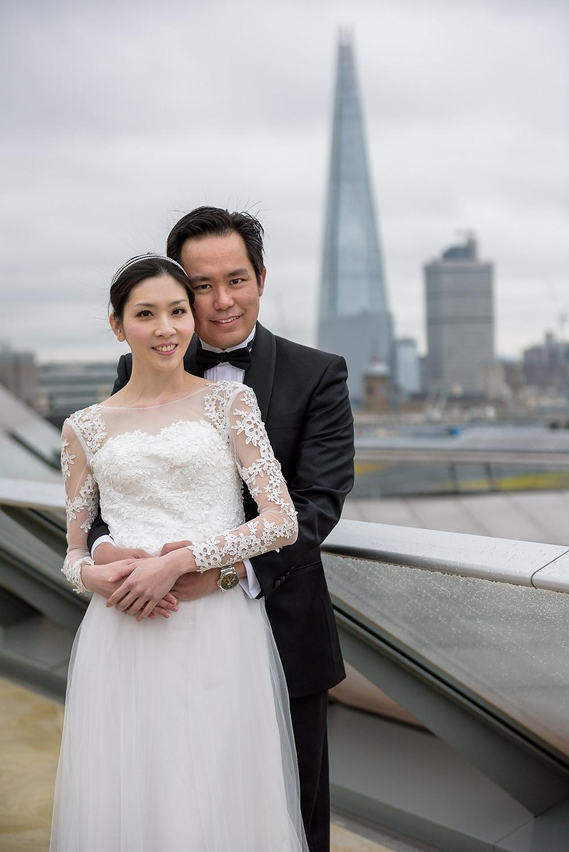 asian couple posing shard london