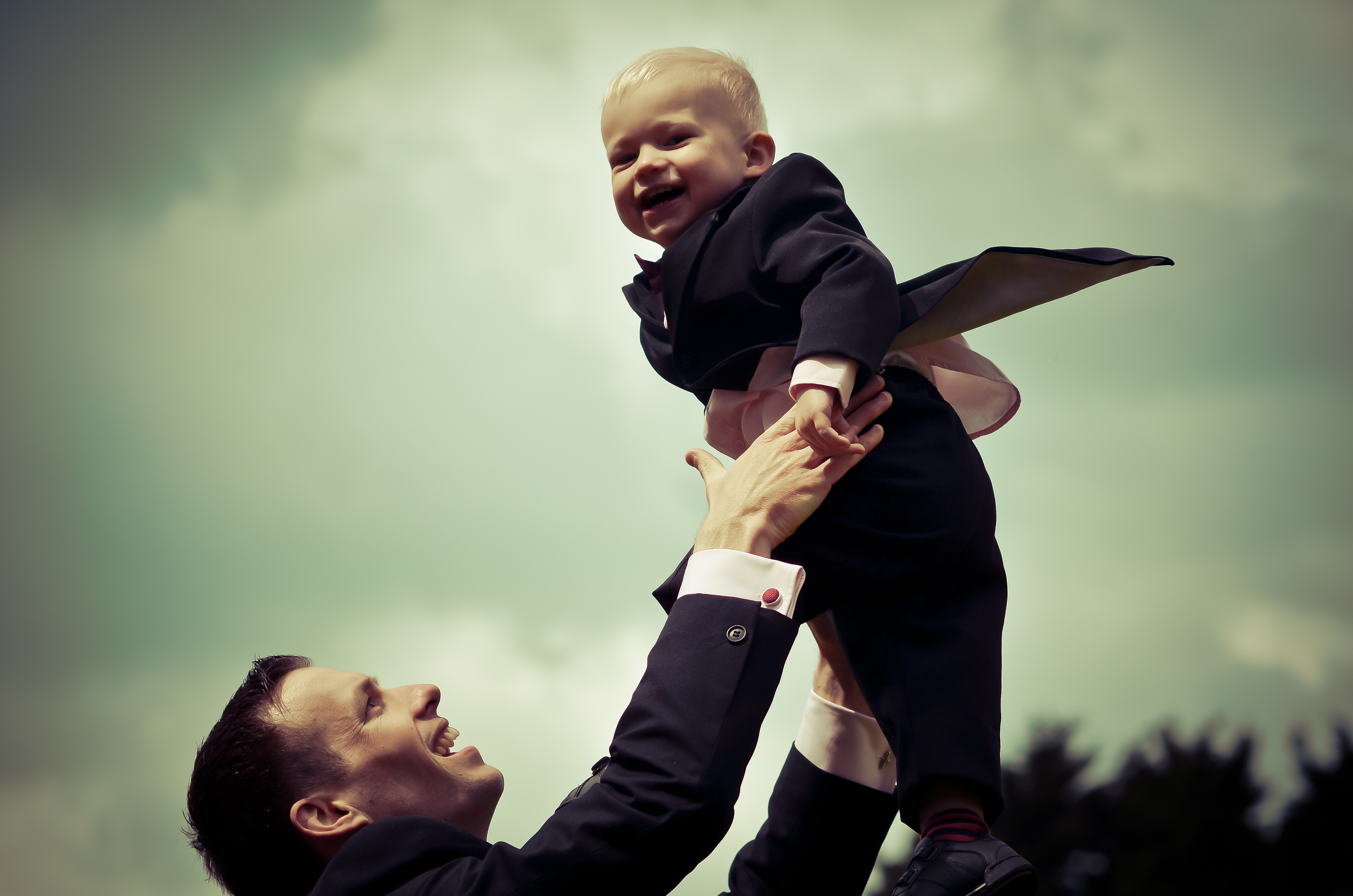 Groom and son at wedding