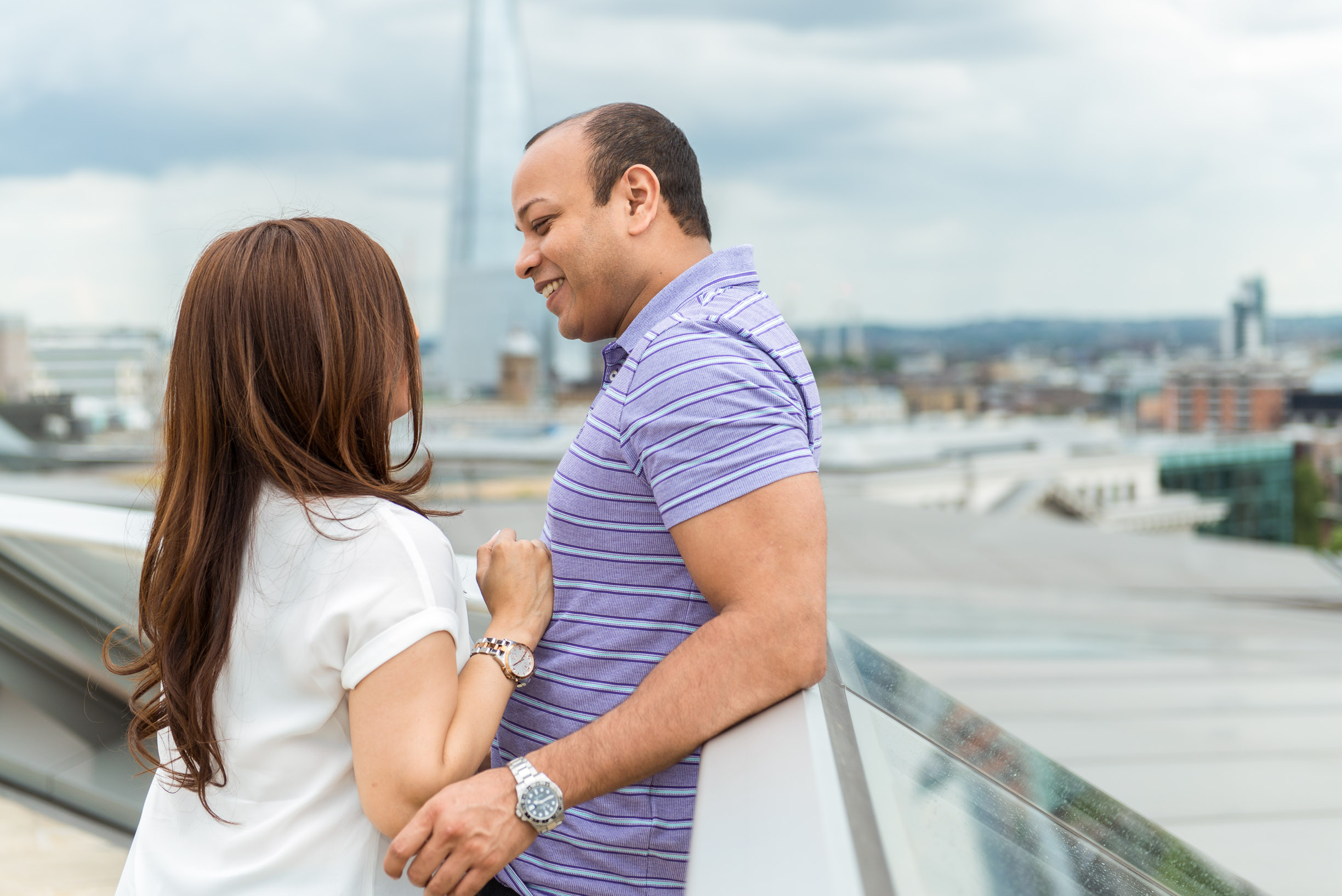 happy couple facing london shard