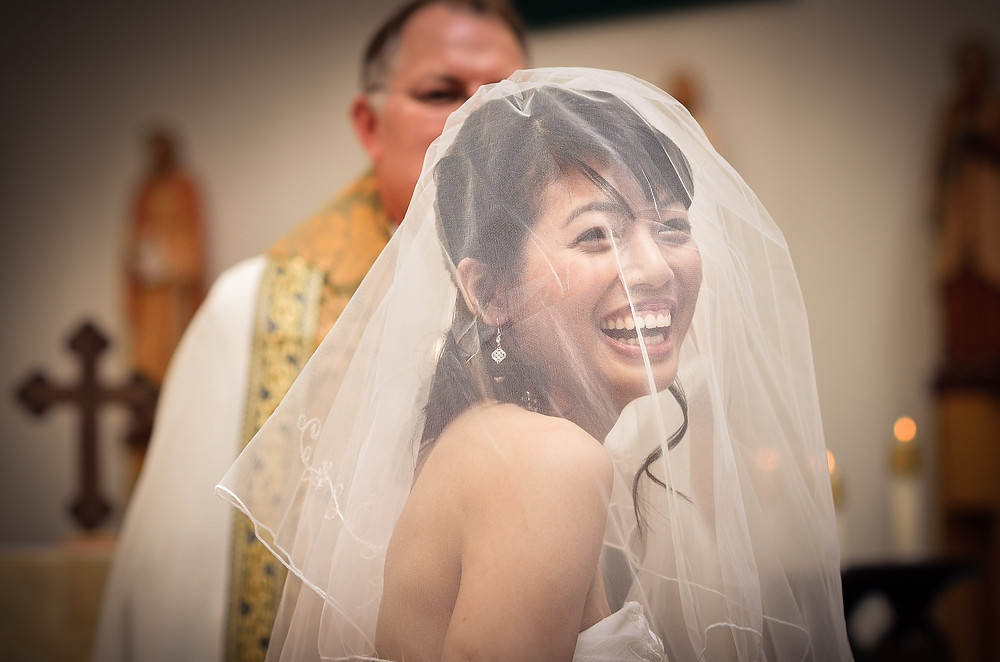 laughing bride in church