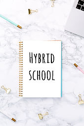 Notepad with Hybrid school wording, lapt