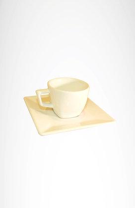 Taza cuadrada de cafe y te