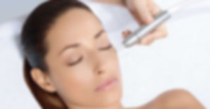 Beautiful woman receiving microdermabrasion