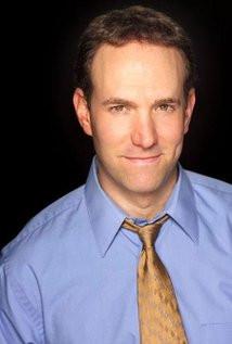 Comedian Greg Benson headshot.