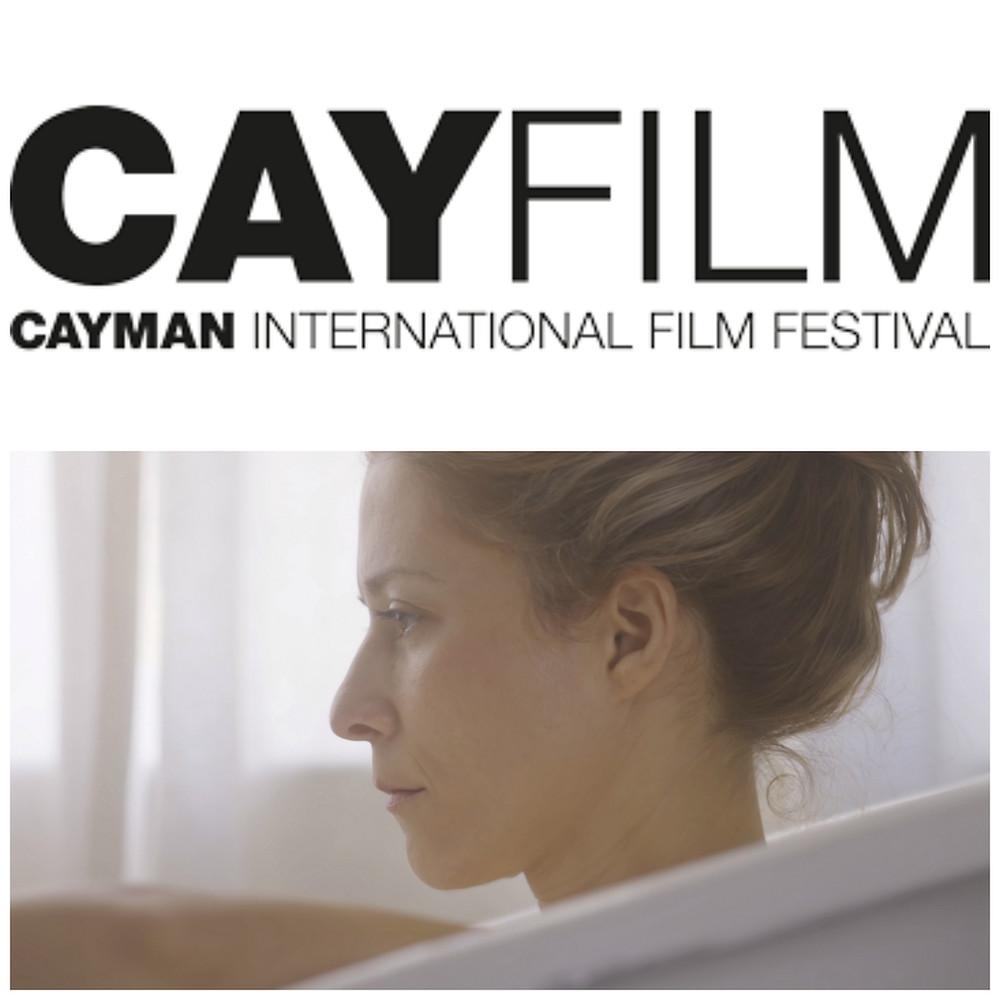 """A film still from """"As It Seems"""" underneath the Cayfilm Cayman International Film Festival logo."""