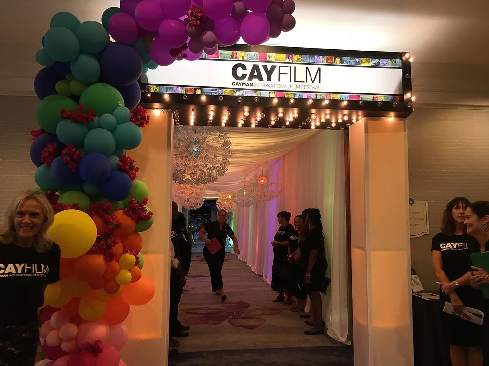 Closing night banner for the CayFilm Cayman International Film Festival.
