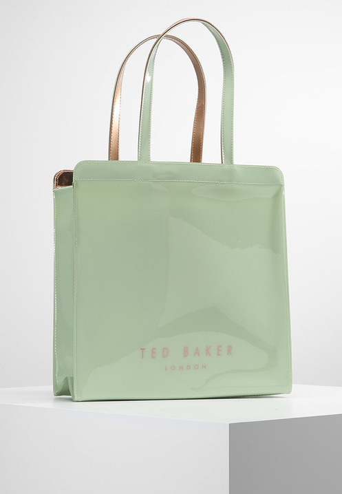 1c8a05ef7d0 Add a touch of signature Ted style to your everyday look with the  always-elegant VALLCON bag. A large shopper bag with a pretty bow detail,  it also makes a ...