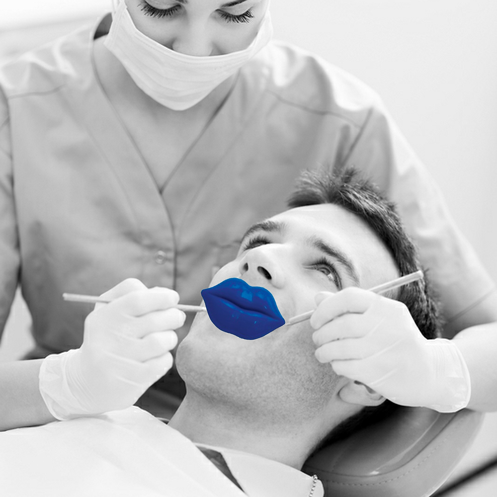 Dental check-up image with blue lips on patient to symbolise mouth cancer action month