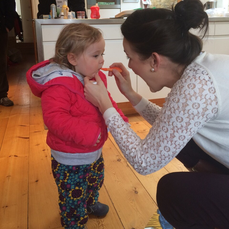 Dr Ciara Sutherland brushing her niece's teeth