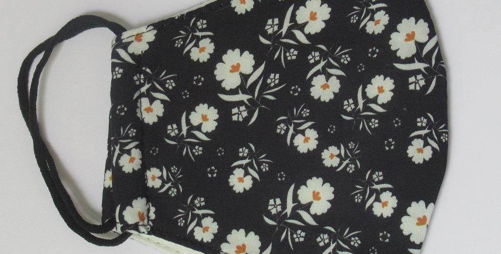 Masque en tissus noir fleurs blanches