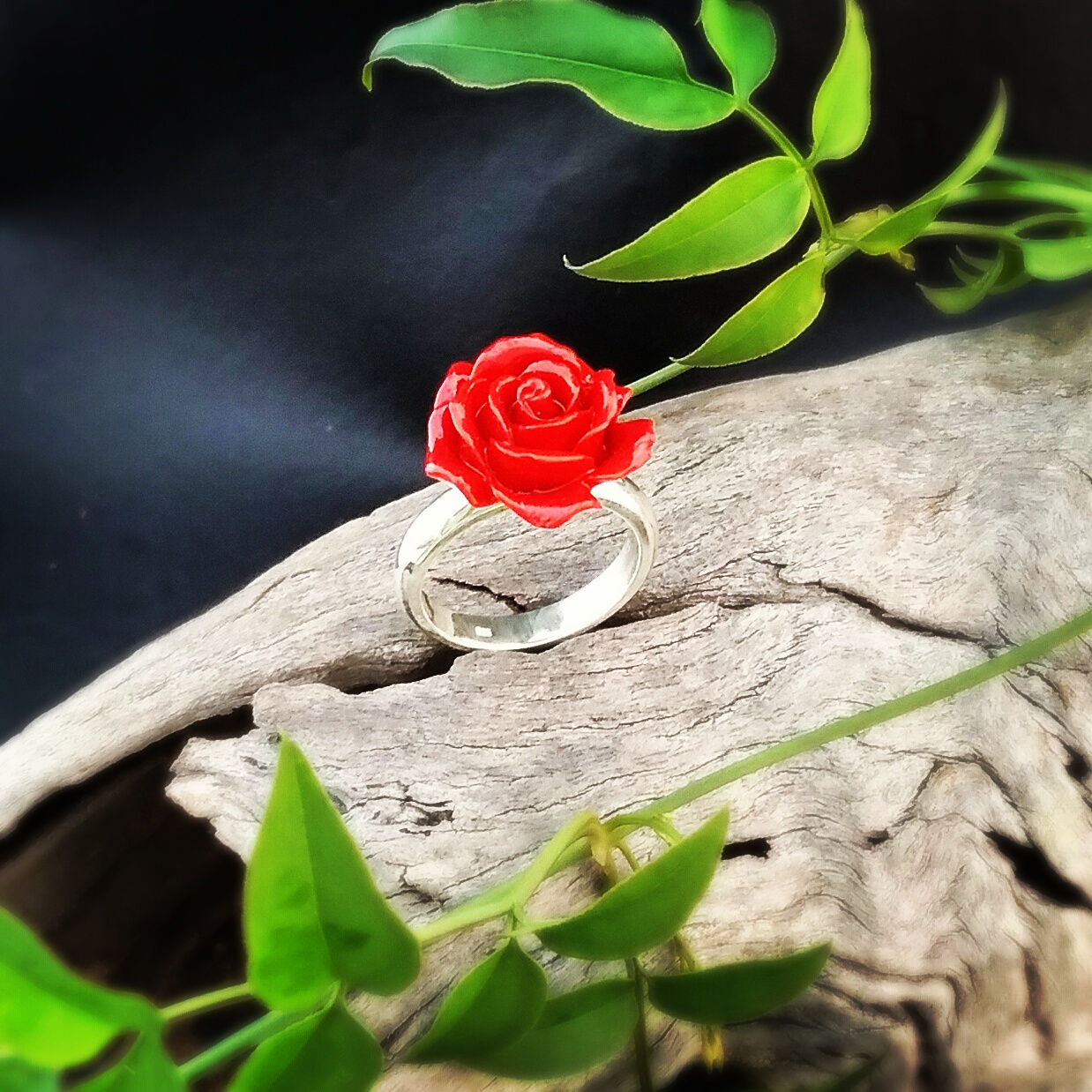 Silver ring with red rose