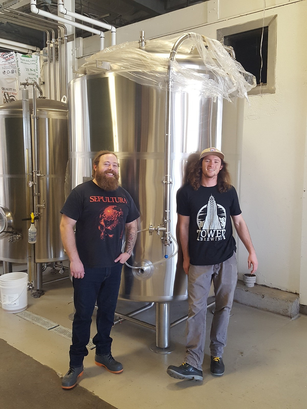 Tower's brewers stand in front of brite tank