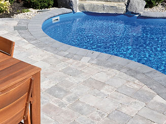 Patio stones around a pool from Simcoe Building Centre.