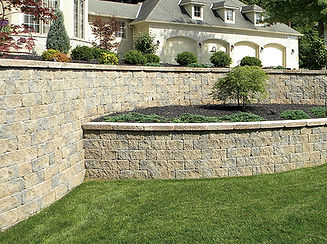 Backyard retaining wall with landscape stones from Simcoe Building Centre.