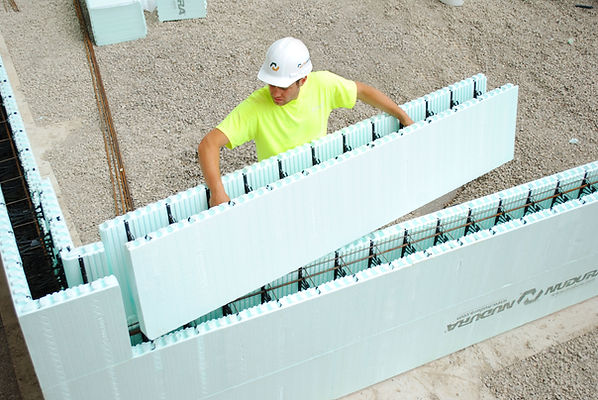Nudura standard ICF block install.